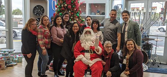 Hope Street Staff smile with Santa